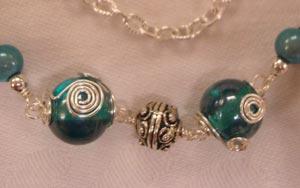 student's wrapped beads and loops necklace